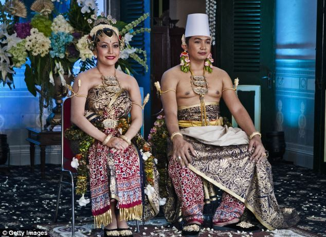 YOGYAKARTA, INDONESIA - OCTOBER 22: KPH Notonegoro and Gusti Kanjeng Ratu Hayu pose for a photograph during their wedding ceremony in Bangsal Kesatriyan at Kraton Palace on October 22, 2013 in Yogyakarta, Indonesia. The Royal Wedding Held For Sultan Hamengkubuwono X's Daughter Gusti Ratu Kanjeng Hayu And KPH Notonegoro. Wedding celebrations will take place October 21-23 October. The wedding parade will include 12 royal horse drawn carriages and will be streamed live on the internet so that…