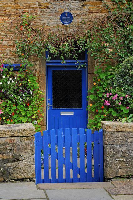 cobalt blue garden gate and door: Stromness, Orkney, Scotland