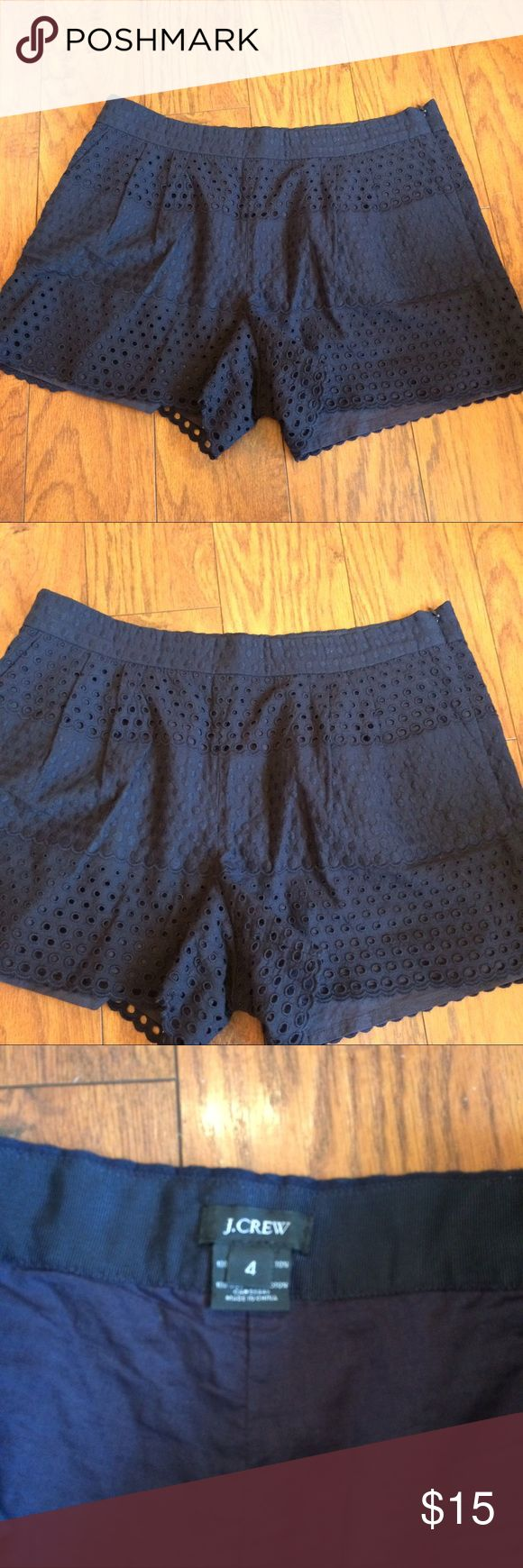 "J Crew Navy Blue Eyelet Shorts Side Zip Size 4 J Crew navy blue eyelet shorts - size 4. Side zipper close. Two pockets. Lined. Ruffle hem. Measures 13"" in length, 3"" inseam, 10"" rise & 15.5"" at waist. Excellent condition- no flaws or wear J. Crew Shorts"