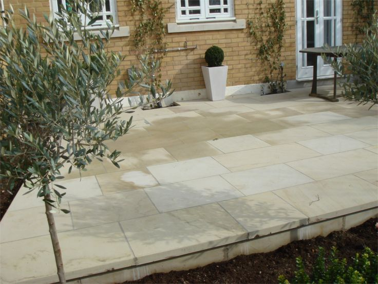 MODERN YORKSTONE TERRACE. We supply best quality reclaimed yorkstone paving, new yorkstone paving, yorkstone steps and yorkstone coping stones, yorkstone paving prices