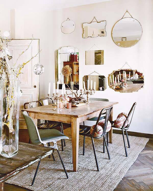 Mirrors reflect dining table.