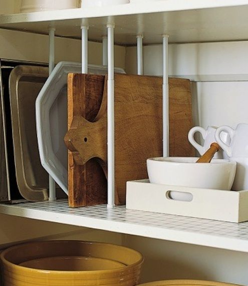 DIY Kitchen Storage tension rod shelf dividers plus 7 other pantry hacks and kitchen storage ideas! We especially love the wine glass holders. Find more great kitchen and food pins from Dinespot.com!