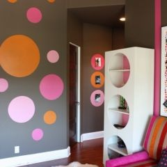 MJ. other view of the pink, orange, red, white & grey girls bedroom.  This view shows lots painted polka dots. fun