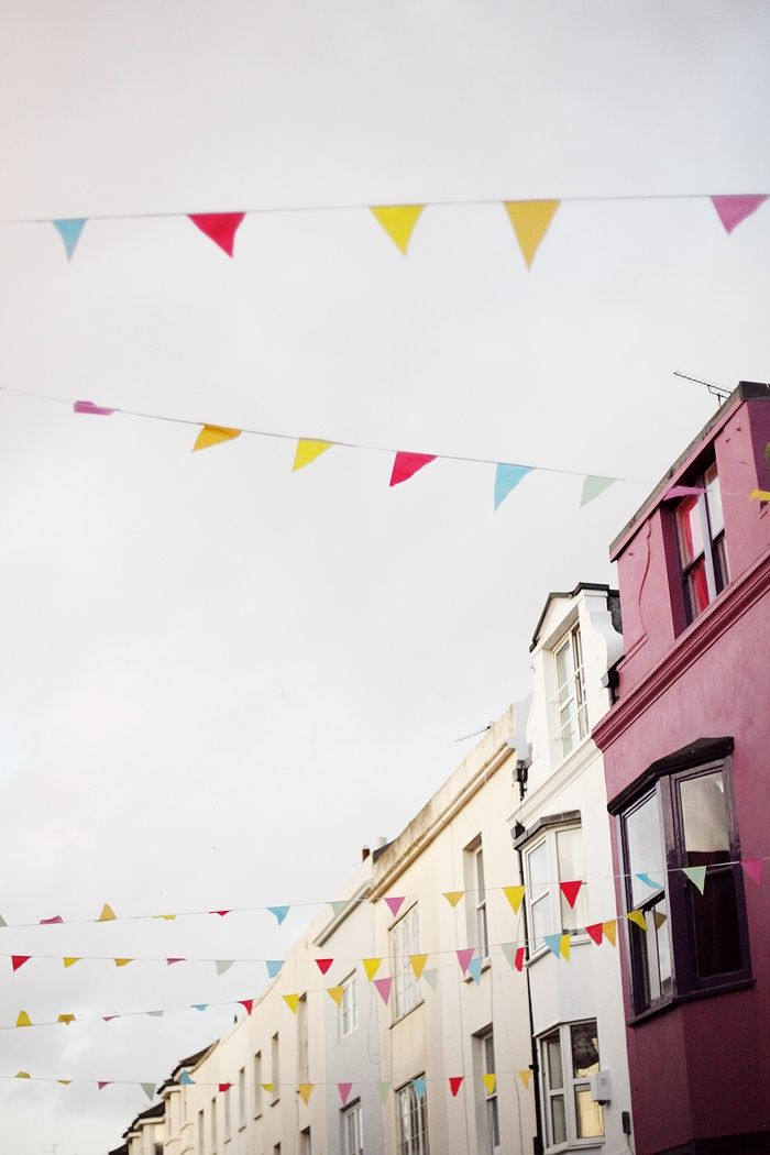 We like the idea of some combo of flags and or papel picado and lights for the main street.