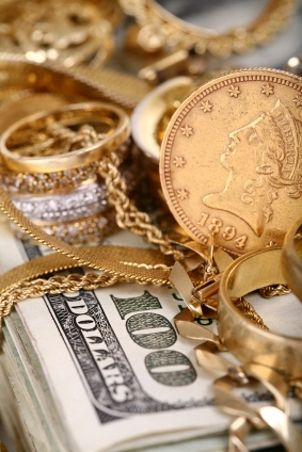 Pile Jewellery | pile of scrap gold on a stack of money that can be acquired by ...