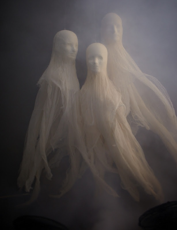 Halloween cheesecloth ghosts.  Really neat, simple idea.
