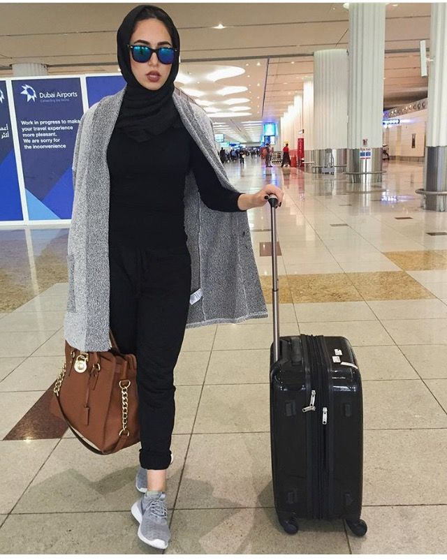 A woman in a hijab at an airport. This is a place where Muslim woman face a lot of discrimination.