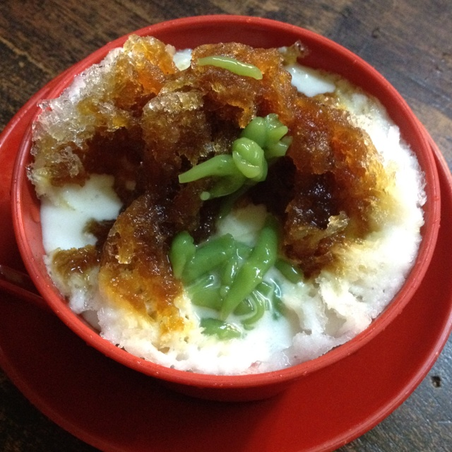 Nyonya Cendol. Best on A Blistering Hot Day! Coconut milk, sweet palm sugar with Pandan flavored tapioca bits!