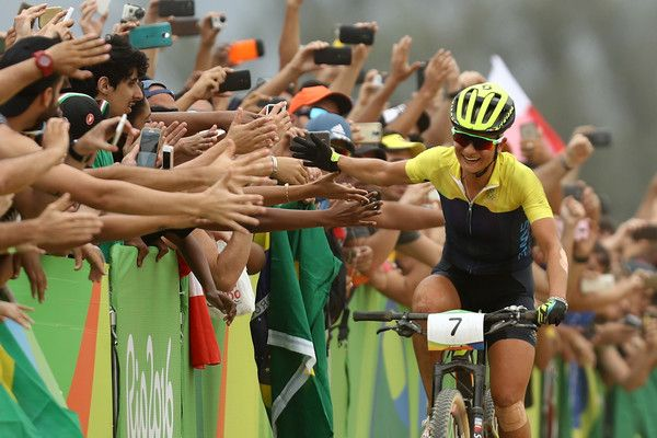 Jenny Rissveds of Sweden celebrates after winning the Women's Cross-Country Mountain Bike Race on Day 15 of the Rio 2016 Olympic Games at the Mountain Bike Centre on August 20, 2016 in Rio de Janeiro, Brazil.