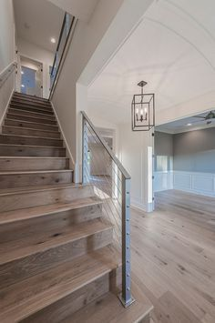 Barrel Ceiling Foyer with steel cable railing staircase and wide plank oak floors. Floor is Chesapeake Flooring White Oak, Provence Manor Outback.