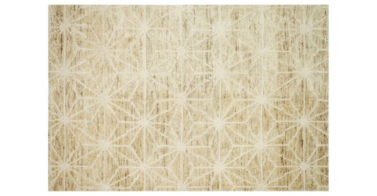 The rustic texture of jute meets the iconic elegance of wool on this neutral foundation. Painstakingly hand-knotted it will be a beautiful foundation in your home for years to come. A rug pad is...