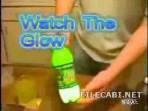 To make mountain dew glow in the dark follow these steps: 1:Pour out 3/4 of dew from the bottle 2:Put a little bit of baking soda in the bottle 3:Add three c...
