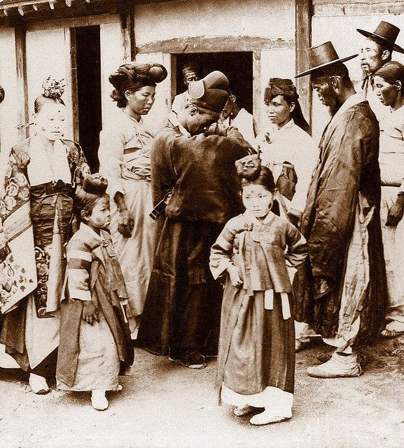 A Wedding Party in Seoul poses for a portrait. Korea, 1900s