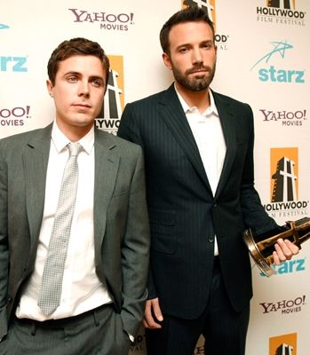 The Affleck brothers, Casey & Ben, pose backstage