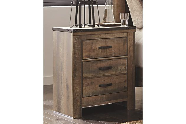 Whether she loves horses or he's a cowboy at heart, Trinell nightstand matches their authenticity. Rustic finish, plank-style details and nailhead trim pay homage to reclaimed barn wood, making for a chic look loaded with charm. A built-in charging station for tablets, cellphones and other electronics offers an up-to-date convenience.