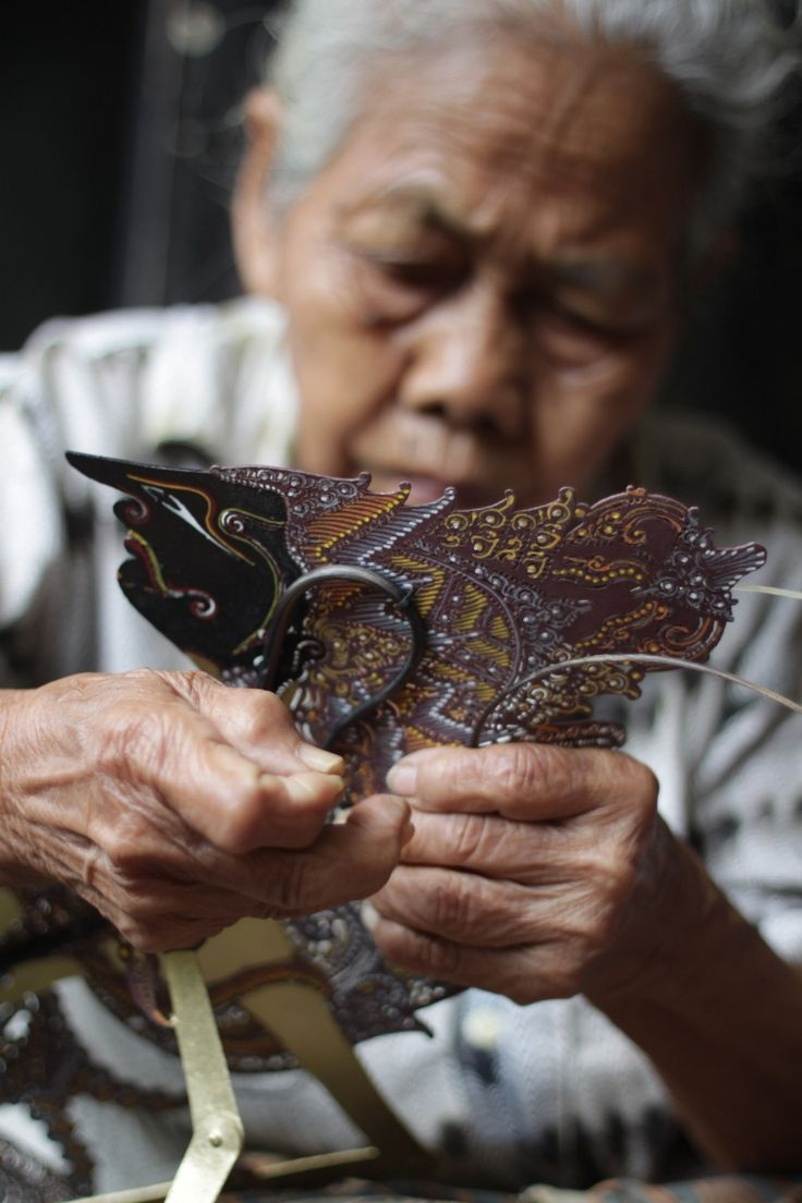 by Ilham Brahmantya on 500px - Old lady making a wayang traditional puppet from Indonesia