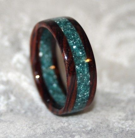 A custom ring using Cocobolo Rosewood and recycled Corian.  ( Etsy link  :: http://www.etsy.com/shop/MnMWoodworks  : )