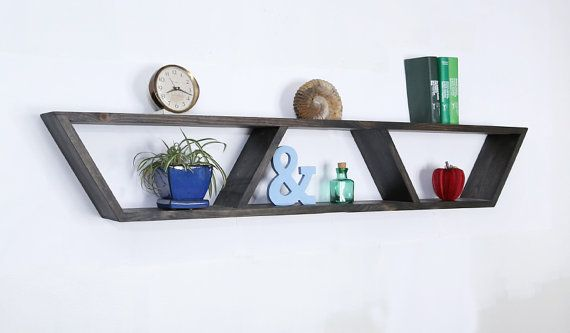 Inspired from Mid Century Modern design, this heavy-duty floating Trapezoid shelf offers clean, modern lines without sacrificing utility - giving