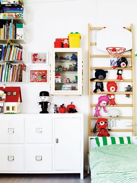 LOVE the ladder as a headboard for stuffed animal storage!