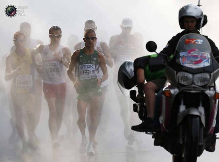 COOLEST SPORTS PIX OF 2013 WEEK 33 - Heffernan of Ireland comes out of the cooling mist in the men's 50 km race walk final during the IAAF World Athletics Championships in Moscow . DENIS BALIBOUSE/REUTERS