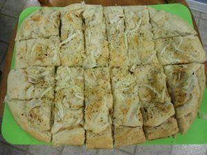 Argentina: Fugazetta (Mozzarella stuffed pizza)