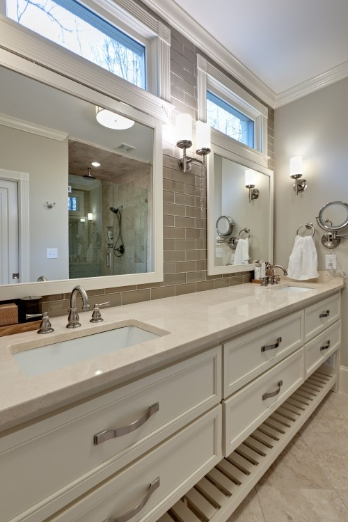 bath: lots of counter space, grey glass subway tile, and windows above the mirrors to let in light