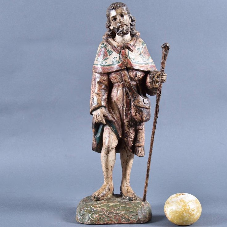 Spanish carved wood and polychrome figure of San Roque (Saint Roch), standing on a rectangular plateau. Circa 1700