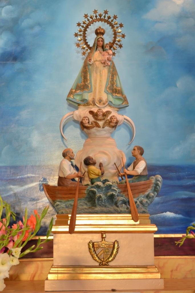 La Caridad del Cobre (The patron saint of Cuba) - the Catholic Saint used to represent Ochun.