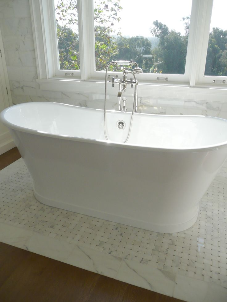 Freestanding tub in front of window | Traditional bathroom ...