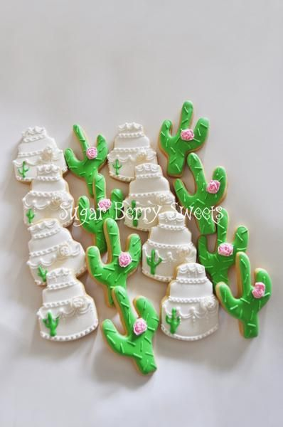 You will receive one dozen White Desert themed Cookies, approximately 3 by 2 in. 6 cactus cookies (with pink fondant roses) 6 wedding cake cookies (with white fondant roses) Each cookie will be indivi