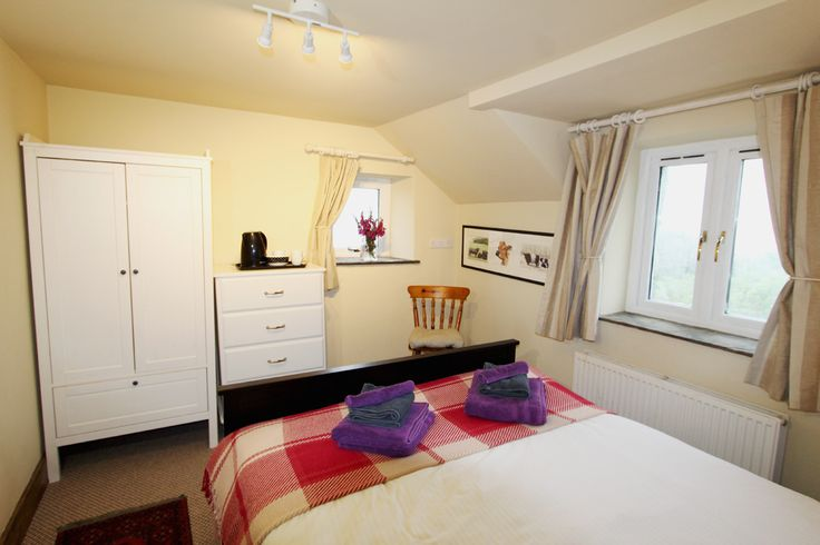 This luxury holiday cottage has a bedroom downstairs and two further spacious and welcoming bedrooms, and a family bathroom.