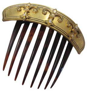 "Victorian tortoise hair comb, circa 1860, decorated with high-karat gold and diamonds in fleur-de-lis pattern. One of the gems that make up ""Finer Things"" —a new exhibit at Stan Hywet Hall & Gardens in Akron, Ohio that showcases   the fashion taste of a turn-of-the-century rubber tycoon and his wife"