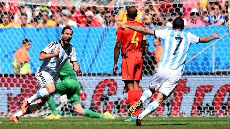 Gonzalo Higuain, left, of Argentina celebrates scoring his team's first goal during a World Cup quarterfinal match against Belgium on Saturday, July 5