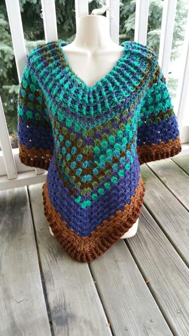Hot Off My Hook! Project: Cowl-Neck Poncho Started: 07 Oct 2015  Completed: 09 Oct 2015 Model: Madge the Mannequin Crochet Hook(s): 7mm, Cowl portion J, Granny Stitch Yarn: Bernat Super Value Stripes, Redheart Super Saver, Redheart Soft Redheart, Bernat Super Value Color(s): Jungle Green Stripes, Denim, Toast, Walnut Pattern Source: Simply Crochet Magazine Issue No. 25 Pattern Designed By: Simone Francis Notes: This is my 34th Cowl-Neck Poncho!