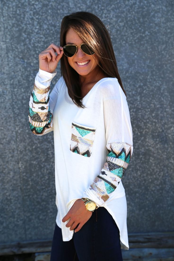 Love how the sequins matches on the arms and the pocket - Need a shirt this style in a small since its a loose fit.
