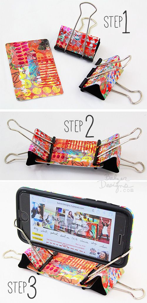 from the Balzer Designs Blog: Artful Binder Clip Phone Stand. Tutorial on her website.