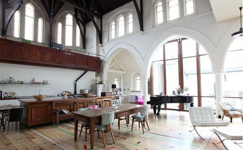 30 foot ceilings, cathedral windows, baby grand, Barcelona chair. I kind of can't believe this space exists.