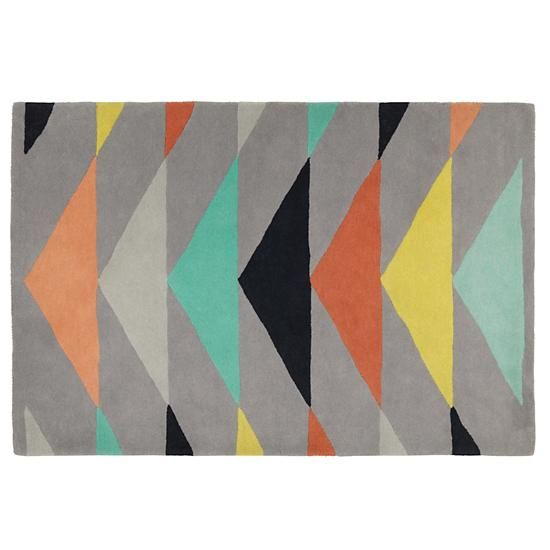 Great triangle motif on this grey, green, orange, yellow and black Isosceles Rug from The Land of Nod