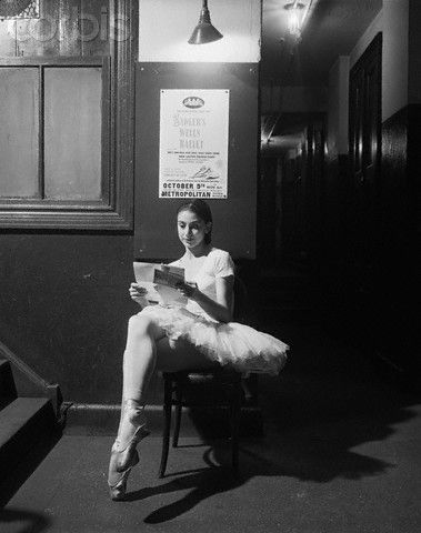 Ballet dancer Margot Fonteyn reads a letter from home between rehearsals at the Metropolitan Opera House.