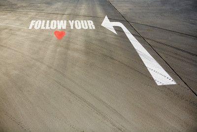 Heart shape and arrow on road