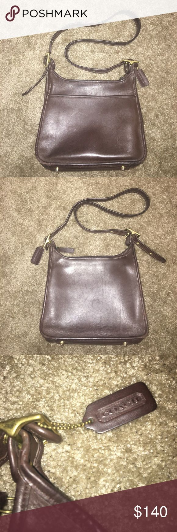 Vintage Coach Buckle Brown Leather Crossbody Purse Vintage Coach with feet.  Some minimal scratching on the leather and in great condition.  Inside zipper and outer pocket.  Small stain on back, see last pic.  9 H X 10.5 L X 4 W. Coach Bags Crossbody Bags