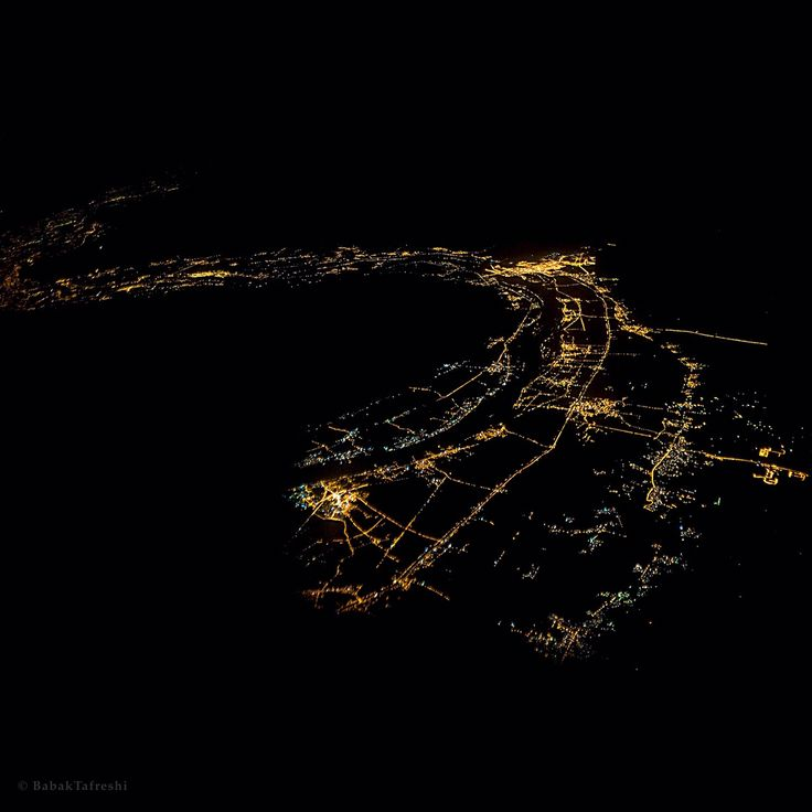 Photo by @babaktafreshi, The World at Night photography  This gigantic snake of light is Nile riverside at night. Swipe Left to locate this spot on NASA's Earth at Night satellite map (lower right). I was on a flight over Egypt when this came to view. The lights quickly disappear on both sides of the river due to unpopulated vast desert. @natgeocreative @natgeo #lightpollution #egypt #aerial #aerialphotography #nightphotography #nile
