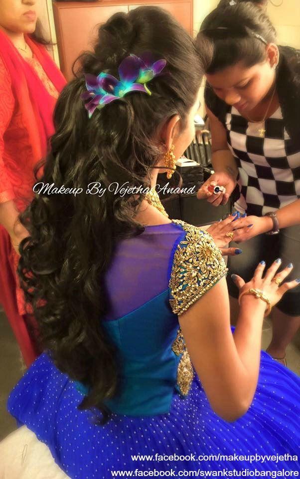 Indian bride's reception hairstyle by Swank Studio. Orchids. Hair Accessory. Lehenga. Curls. Tamil bride. Telugu bride. Kannada bride. Hindu bride. Malayalee bride. Find us at https://www.facebook.com/SwankStudioBangalore