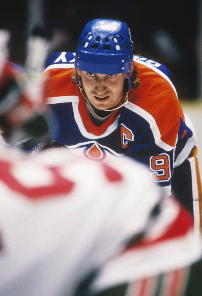 The Edmonton Oilers' captain Wayne Gretzky lines up for a face off against the New Jersey Devils at the Meadowlands Arena circa the 198788 season in...