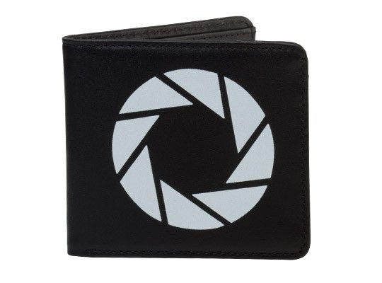 Rigorous tests have shown that subjects find it difficult to transverse portals and defy the laws of physics while keeping their identification and monetary transaction elements organized. The Aperture Science Wallet has shown to lessen the effects of lost cards and bills when conducting tests within the grounds of the Aperture Science testing facility.