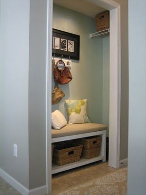 Coat closet turned mud room. I like this idea. Very clever!