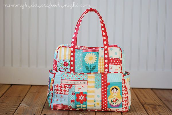 Mommy by day Crafter by night: My Quilted Weekender Bag -- so cute. I SO want a weekender of my own, but I'm so intimidated to even try and tackle the pattern. Oi!