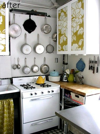 Small Kitchen: Extra Large (cork board?) that takes up the whole wall for decorative, cohesive Cookware Storage. <3 the magnetic knife/scissor rack wall rack (+ 30 other s.kitchen ideas in link)