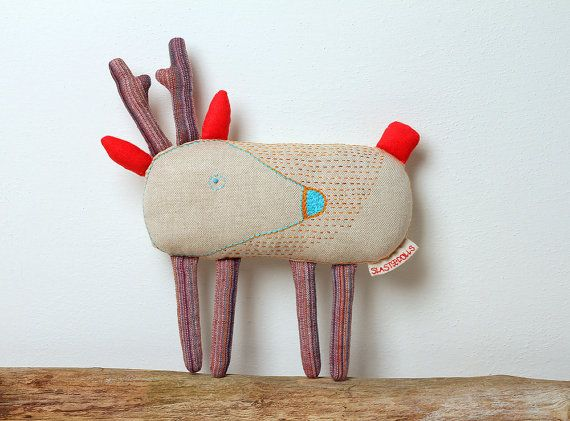 Deer - is a designer toy. It is hand-embroidered, and sewn partially by hands and on a sewing machine. The label (which is on the toy) is also