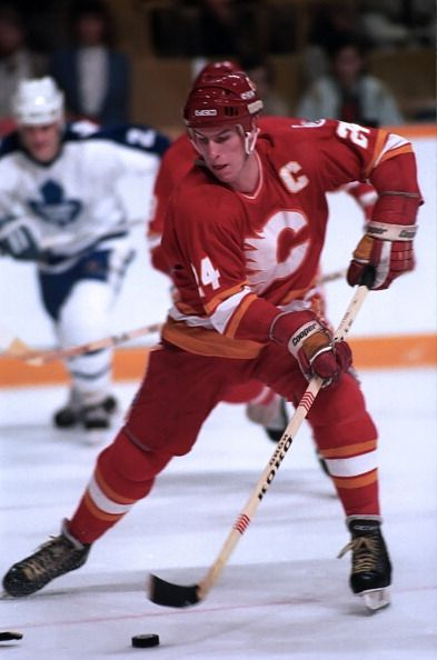 Jim Peplinski of the Calgary Flames skates up ice against the Toronto Maple Leafs during game action October 27 1984 at Maple Leaf Gardens in Toronto...